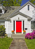 House with a red door. Royalty Free Stock Photo