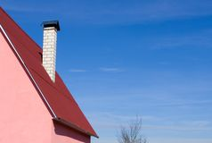 House with a red roof. The house with a red roof against the blue sky royalty free stock images