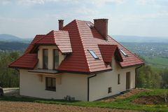 House with red roof. And yellow walls Stock Photo