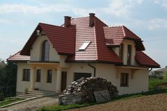 House with red roof. And yellow walls Royalty Free Stock Images