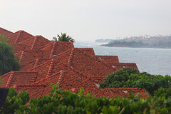 House with red roof on the beach Royalty Free Stock Photos