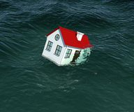 House with red roof sinks in water Royalty Free Stock Photo