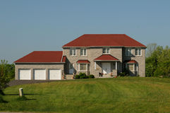 House with red roof and triple garage Stock Photos