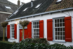 House with red shutters Stock Image