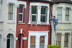 Home improvements. A handyman working on the outside of a house Royalty Free Stock Photos