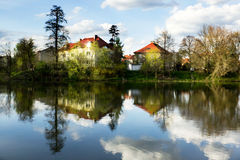 House reflected in calm water Stock Images