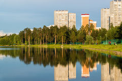House reflected in lake at sunset light in Zelenograd district of Moscow, Russia Royalty Free Stock Image