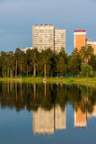 House reflected in lake at sunset light in Zelenograd district of Moscow, Russia Stock Photos