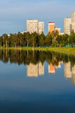 House reflected in lake at sunset light in Zelenograd district of Moscow, Russia Stock Image