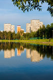 House reflected in lake at sunset light in Zelenograd district of Moscow, Russia Royalty Free Stock Photos
