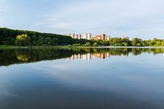 House reflected in lake at sunset light in Zelenograd district of Moscow, Russia Royalty Free Stock Photo