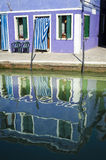 House and reflection in a canal, Burano, Italy Stock Photos