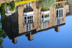 House reflection in river stream, Knaresborough UK. House reflection on the surface of river Nidd, taken in bright summer sunlight in the Mother Shipton park Royalty Free Stock Photos
