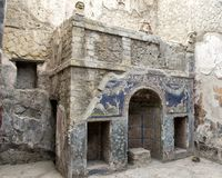 House 22 in the remains of Herculaneum Parco Archeologico di Ercolano. Pictured is House Number 22, noted for this outstanding summer triclinium with a nymphaeum Royalty Free Stock Photo