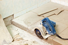 House renovation. Laying floor tiles for house renovation royalty free stock image