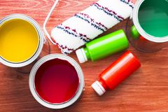 House renovation concept, paint cans and brushes. House renovation, bottles with paint and paint roller on the old wooden background top view stock photos