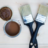 House Renovation, Brown Paint Can and Brush Royalty Free Stock Image