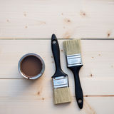 House Renovation, Brown Paint Can and Brush Royalty Free Stock Photography