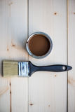 House Renovation, Brown Paint Can and Brush Royalty Free Stock Images