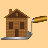 Built a new house made of brick standing on tool trowel Stock Image