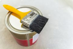 Free House Renovation. Can With Paint And A Brush Tool On Concrete Ba Royalty Free Stock Photography - 105854147