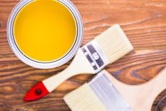 House renovation concept, colorfull paint cans and paintbrushes on dark wooden background royalty free stock photos