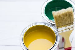 House renovation concept, colorfull paint cans and paintbrushes on wooden background. Top view stock images