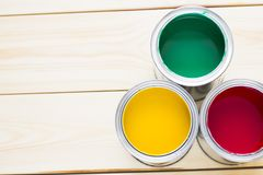 House renovation concept, colorfull paint cans on wooden background. Top view stock images