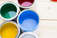 House renovation concept, colorfull paint cans on wooden background. Top view royalty free stock image