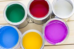 House renovation concept, colorfull paint cans on wooden background. Top view royalty free stock photos