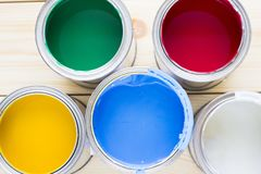 House renovation concept, colorfull paint cans on wooden background. Top view royalty free stock images