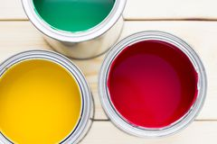 House renovation concept, colorfull paint cans on wooden background stock image