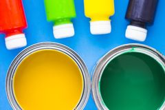 House renovation concept, paint cans and brushes. House renovation, paint cans on blue background top view stock photos