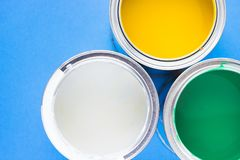 House renovation concept, paint cans and brushes. House renovation, paint cans on blue background top view stock image