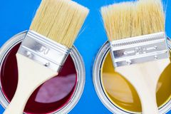 House renovation concept, paint cans and brushes. House renovation, paint cans and paintbrushes on blue background top view royalty free stock photos