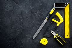 House renovation with implements set for building, painting and repair black table background top view mockup Royalty Free Stock Images