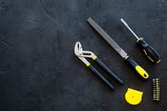 House renovation with implements set for building, painting and repair black table background top view mockup Royalty Free Stock Photo