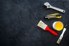 House renovation with implements set for building, painting and repair black table background top view mockup Stock Image