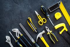 House renovation with implements set for building, painting and repair black table background top view mockup Stock Photo