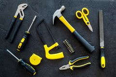 House renovation with implements set for building, painting and repair black table background top view pattern Stock Images