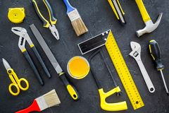 House renovation with implements set for building, painting and repair black table background top view pattern Royalty Free Stock Images