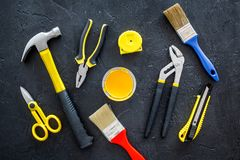 House renovation with implements set for building, painting and repair black table background top view pattern Stock Photos