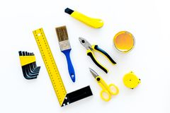 House renovation with implements set for building, painting and repair white table background top view Royalty Free Stock Photography