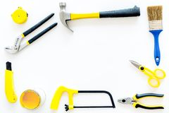 House renovation with implements set for building, painting and repair white table background top view frame mockup Royalty Free Stock Image