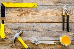 House renovation with implements set for building, painting and repair wooden table background top view frame mockup Royalty Free Stock Images