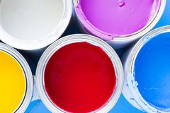 House renovation concept, paint cans and brushes. House renovation, paint cans on blue background top view royalty free stock images