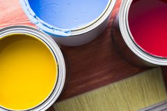 House renovation concept, paint cans and brushes. House renovation, paint cans and paintbrushes on the old wooden background top view royalty free stock images