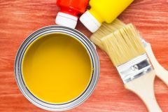 House renovation concept, paint cans and brushes. House renovation, paint cans and paintbrushes on the old wooden background top view stock photography
