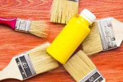 House renovation concept, paint cans and brushes. House renovation, paint cans and paintbrushes on the old wooden background top view royalty free stock photography