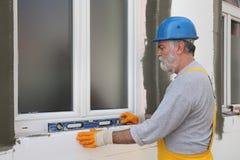 Free House Renovation, Polystyrene Wall Insulation, Level Tool Royalty Free Stock Photo - 79574625